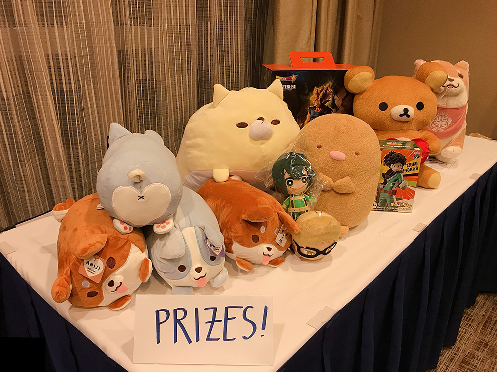 Volunteer for a chance to win these prizes: plushies, Izuku Midoriya figure, Goku figure, and more!